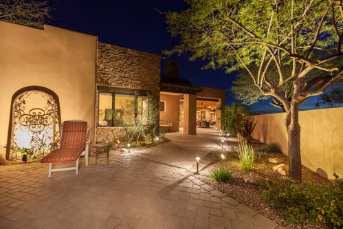 large house with landscape lighting